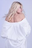 Blond. Woman in white towel turning her head royalty free stock photography