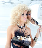 Blond 80s woman with ethnic cancan pearly dress Royalty Free Stock Photos