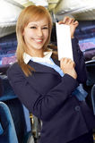Blond air hostess (stewardess). In the empty airliner cabin Royalty Free Stock Photo