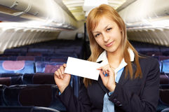 Blond air hostess (stewardess). In the empty airliner cabin Stock Photos