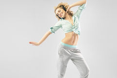 Blond alluring woman dancing alone Stock Photography