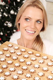 Blond angel with cookies. Beautiful blond angel with some fresh christmas cookies royalty free stock images