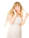 Blond angel girl with telephone royalty free stock image