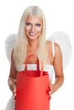 Blond angel with shopping bag Royalty Free Stock Photography