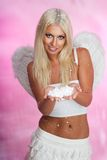 Blond angel with snow Royalty Free Stock Image