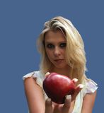 Blond with apple. Temptation of Eve Royalty Free Stock Photos