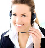 Blond assistant with headset. An blond assistant smiling with a headset Royalty Free Stock Image