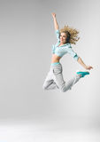 Blond athlete dancing and jumping Stock Photography