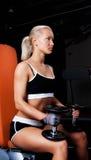 Blond Athlete holding dumbbells Stock Image