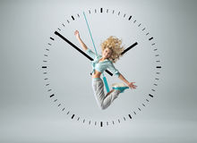 Blond athlete jumping in the clock Royalty Free Stock Images