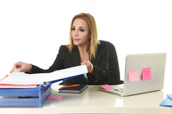 Blond attractive 40s woman in business suit working at laptop co Stock Photo