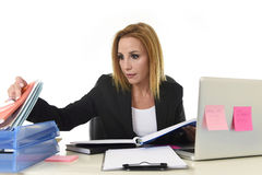 Blond attractive 40s woman in business suit working at laptop co Stock Images