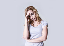 Blond attractive woman on her thirties sad and depressed looking desperate in sorrow Stock Photos