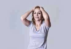 Blond attractive woman on her thirties sad and depressed looking desperate in sorrow Royalty Free Stock Image