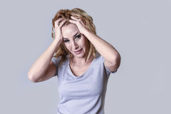 Blond attractive woman on her thirties sad and depressed looking desperate in sorrow Royalty Free Stock Photos