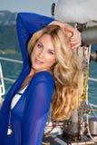 Blond auf der Yacht Stockbilder
