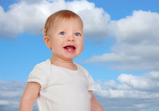Blond baby with blue eyes Stock Photos