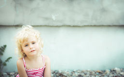 Blond baby girl on the beach. Portrait of a blond baby girl on the beach Royalty Free Stock Photos