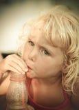 Blond baby girl on the beach Stock Photos