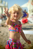 Blond baby girl on the beach. Portrait of a blond baby girl on the beach nice dressed Royalty Free Stock Photos