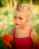 Blond baby girl eating water melon Stock Image