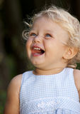 Blond baby girl laughing Stock Photography