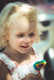 Blond baby girl and lollipop Stock Photo