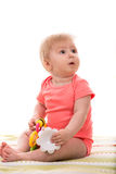 Blond baby girl looking away Stock Images