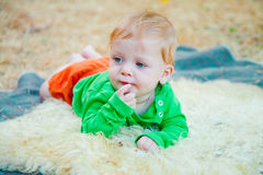 Blond baby looking to the side Royalty Free Stock Photography