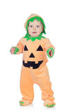 Blond baby in pumpkin suit Stock Photos