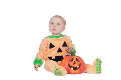Blond baby in pumpkin suit Stock Photo