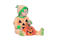 Blond baby in pumpkin suit Royalty Free Stock Photo