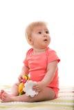 Blond babymeisje die weg kijken Stock Afbeeldingen