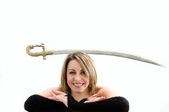 Blond balancing sword Royalty Free Stock Photo