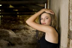 Blond in barn Royalty Free Stock Image