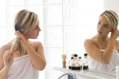 Blond in bathroom Royalty Free Stock Images