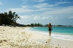 Blond Beach. A pretty blond woman walks a lonely tropical beach Stock Image