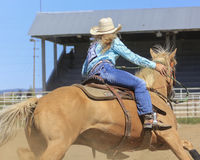 Blond Beauties. Woman competing in barrel racing at a rodeo Stock Photo