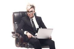 Blond beautiful business lady in white shirt eyeglasses black su Stock Photography