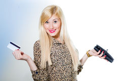 Blond beautiful smiling girl holding wallet and card Stock Photography