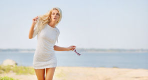 Blond beautiful woman on the beach Royalty Free Stock Photography