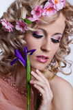Blond beautiful woman with flowers Stock Photography
