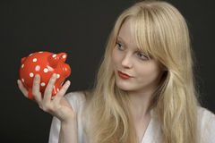 Blond beautiful woman with savings box Stock Photos