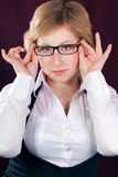 Blond beautiful young woman with glasses Royalty Free Stock Photos