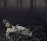 Blond beauty. Laying on leaves Stock Images