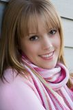 Blond beauty. Beautiful blond girl smiling, dressed in pink Stock Photography