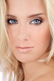Blond beauty. Close-up portrait of beautiful blond blue-eyed girl with golden makeup stock photography