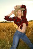 Blond beauty. Blond glamour model posing in western wear Stock Photo