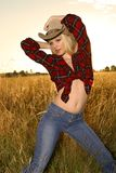 Blond beauty. Blond glamour model posing in western wear Royalty Free Stock Photography