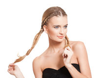 Blond beauty with amazing hair. Portrait of a young blond woman with long healthy hair royalty free stock image